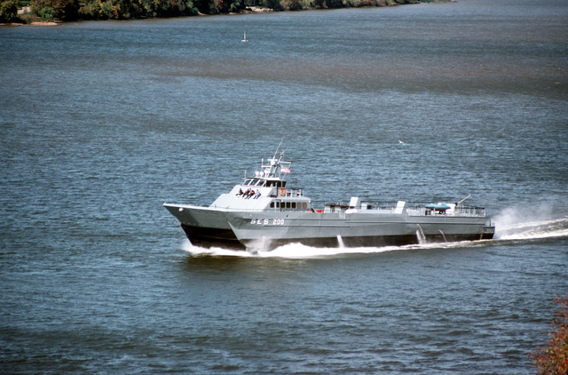 A port bow view of the surface effect ship 200 (SES) underway after departing the Washington Navy Yard. Naval Sea Systems Command procured a 110-foot commercial SES and increased its length by installing a 50-foot hull extension amidships. This was necessary to validate high lenth-to-beam research