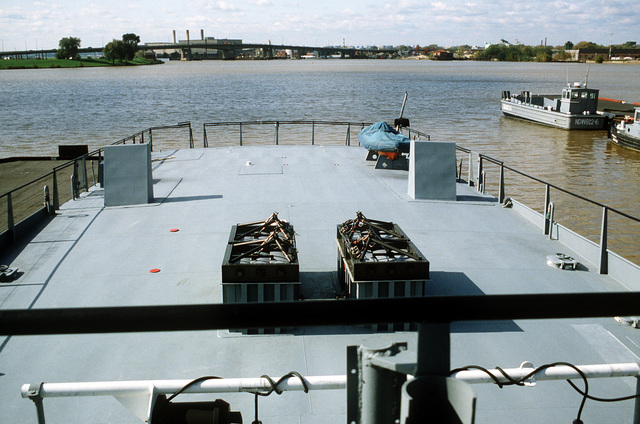 A view looking aft from the bridge on the surface effect ship 200 (SES-200) moored at the Navy Yard. Naval Sea Systems Command procured a 110-foot commercial SES and increased its length by installing a 50-foot hull extension amidships. This was necessary to validate high length-to-beam research
