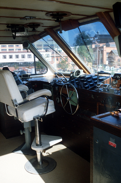 An interior view of the wheelhouse on the surface effect ship 200 (SES-200) moored at the Navy Yard. Naval Sea Systems Command procured a 110-foot commercial SES and increased its length by installing a 50-foot hull extension amidships. This was necessary to validate high length-to-beam research.