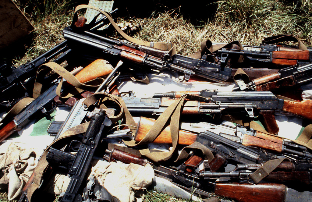 Among the weapons seized during the multi-service, multinational Operation URGENT FURY, are an UZI 9 mm submarine gun, a light machine gun, and assorted AK-47 assault rifles