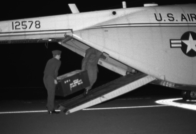 An Air Force Special Activities Center (AFSAC) Human Intelligence Resources (HUMINT) Augmentation Team (HAT) administration kit is loaded aboard a CH-3 helicopter. The kit will be placed aboard a helicopter and transported to Grenada for use during the multiservice, multinational Operation URGENT FURY