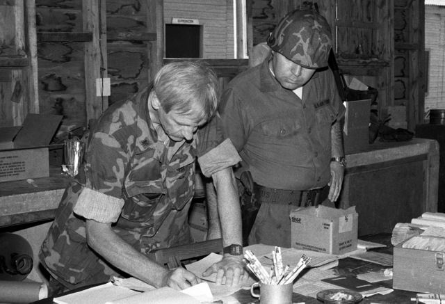 Members of the US Air Force Special Activities Center (AFSAC) Human Intelligence Resources (HUMINT) Augmentation Team (HAT) are processed-in during the multiservice, multinational Operation URGENT FURY