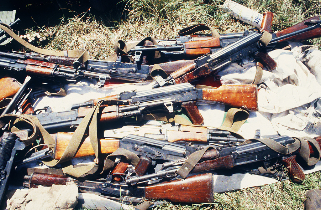 Soviet made AK-47 assault rifles seized during Operation URGENT FURY. Visible to the left is an Israeli made 9 mm UZI submarine gun