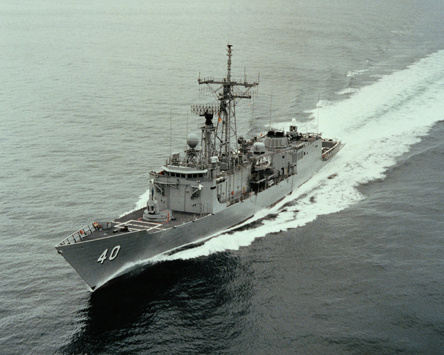 An aerial port bow view of the guided missile frigate HALYBURTON (FFG 40) underway during acceptance trials