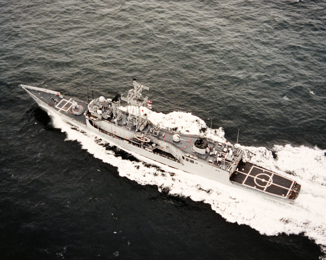 An aerial port quarter view of the guided missile frigate HALYBURTON (FFG 40) during acceptance trials
