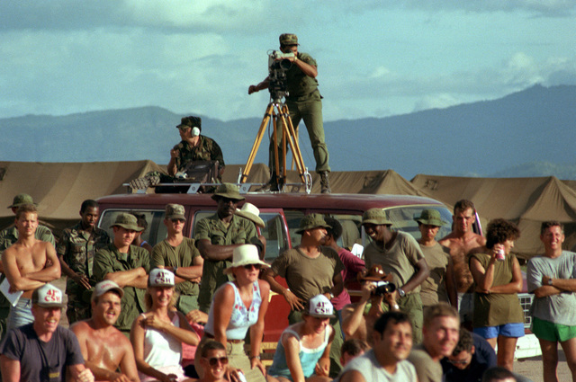 Army personnel watch a USO concert being performed by the band Nickelodeon during the Ahuas Tara II (Big Pine) operation. The show is being filmed by an audiovisual team