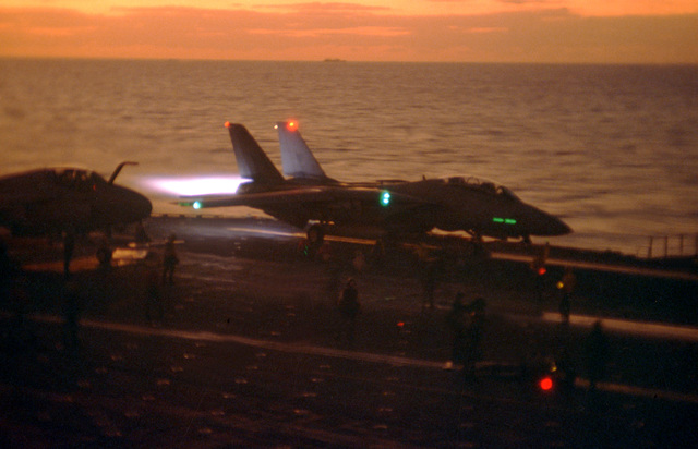 A Fighter Squadron 24 (VF-24) F-14A Tomcat aircraft is launched from the catapult of the aircraft carrier USS RANGER (CV-61). Exact Date Shot Unknown