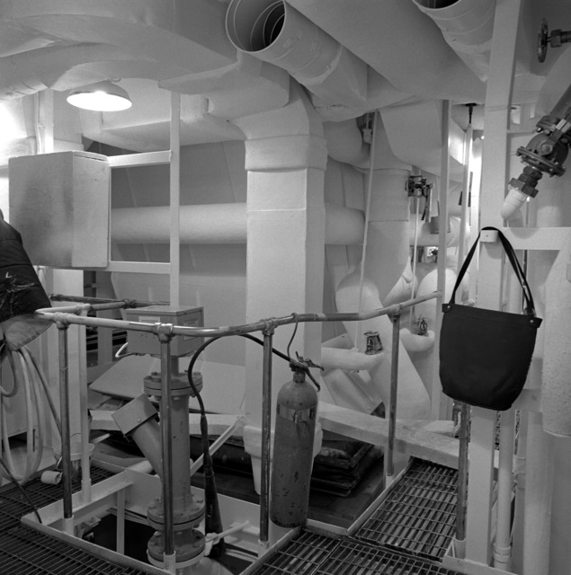 The upper level engine room aboard the guided missile frigate NICHOLAS (FFG-47). The ship is 90 percent complete