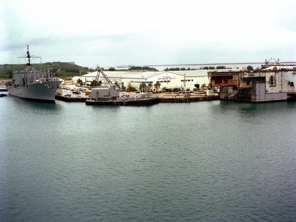 A starboard bow view of the combat stores ship USS NIAGARA FALLS (AFS 3) moored at the US Naval Ship Repair Facility