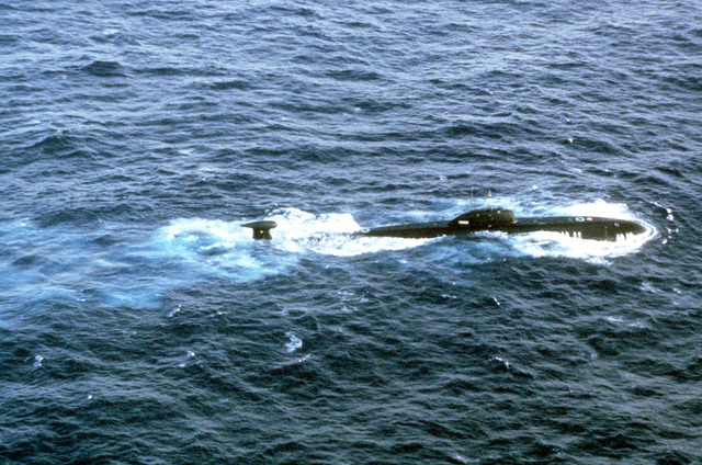 A starboard view of a Soviet Victor III nuclear attack submarine. The submarine, sighted from a Navy P-3C Orion anti-submarine warfare aircraft, from Patrol Squadron 16 (VP-16), is approximately 470 miles east of Charleston, South Carolina and appears to be experiencing some sort of mechanical problems