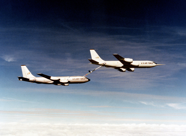 An aerial right side view of a KC-135R Stratotanker aircraft refueling a KC-135R Stratotanker