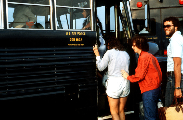 American students board an Air Force bus after arriving from Grenada. The students were evacuated by US military personnel during Operation URGENT FURY