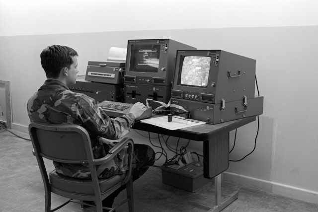 First Lieutenant Tim Schroth tests the MICROFIX battlefield intelligence analysis system. Depot technicians developed the system using commercially available computer components