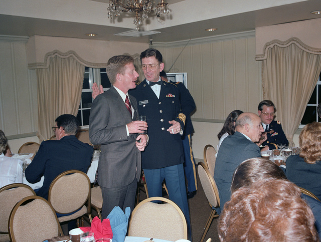 Sergeant (SGT) George M. Rudolph, left, talks with 1ST Sergeant (1SG) Duane E. French, Combat Pictorial Detachment, Fort Meade, Maryland, during the US Army Audiovisual Center's 40th anniversary celebration at the Arlington Hall Station Officers Club