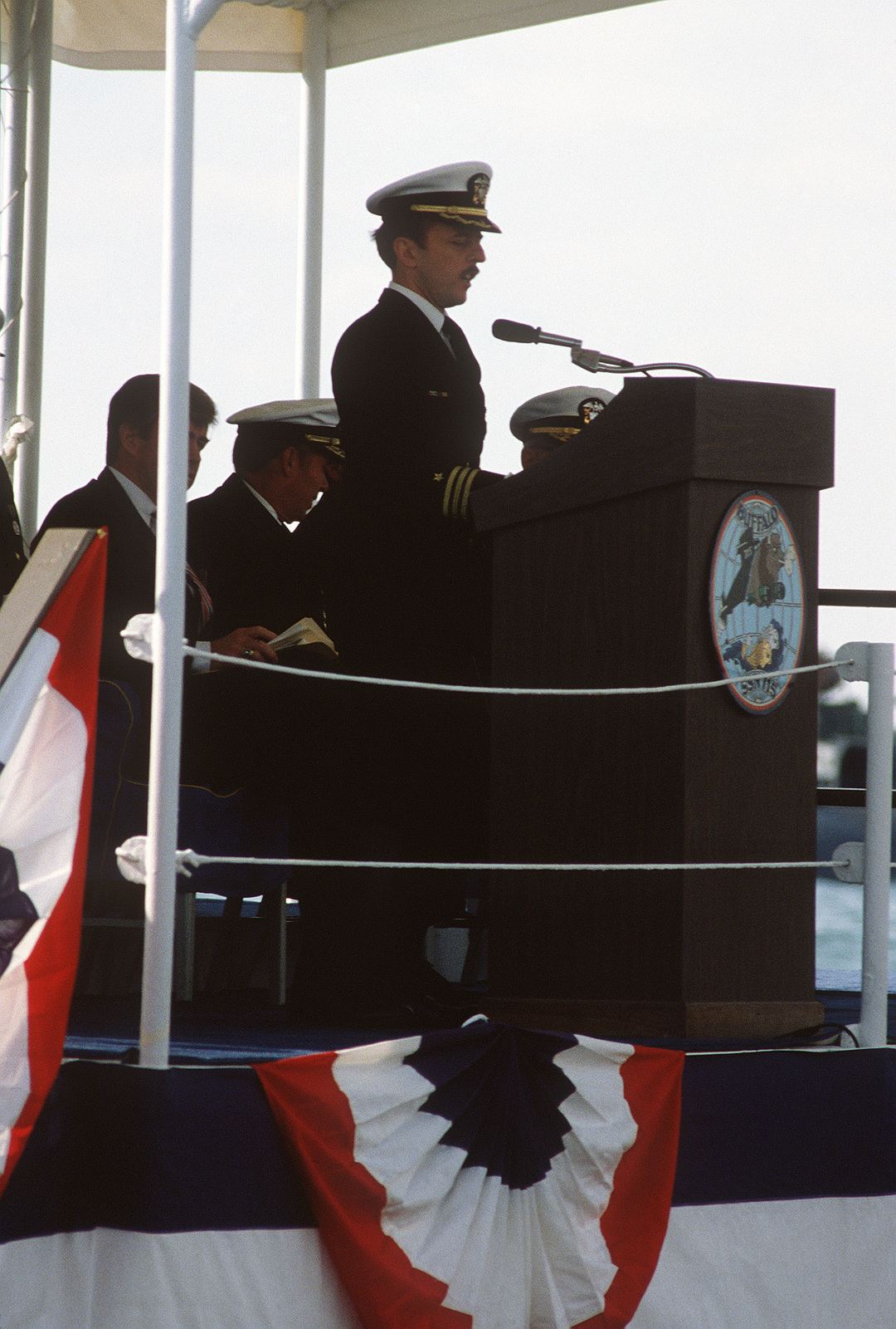 Commander (CDR) G. Michael Hewitt, commanding officer of the nuclear-powered attack submarine USS BUFFALO (SSN 715), speaks during the ship's commissioning ceremony