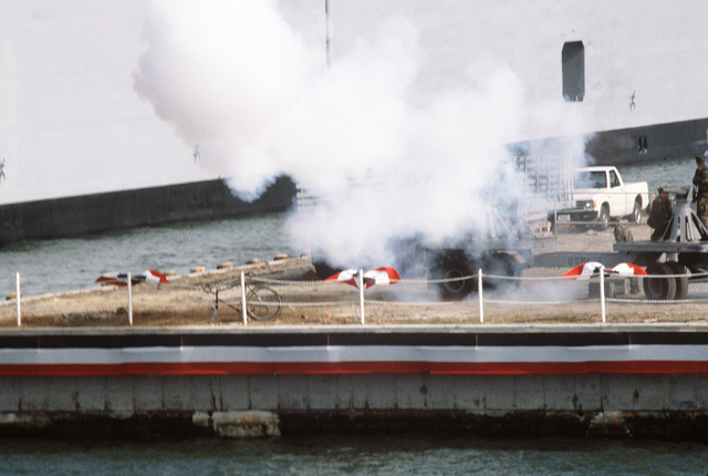 Marines fire a cannon salute during the commissioning ceremony for the nuclear-powered attack submarine USS BUFFALO (SSN 715)