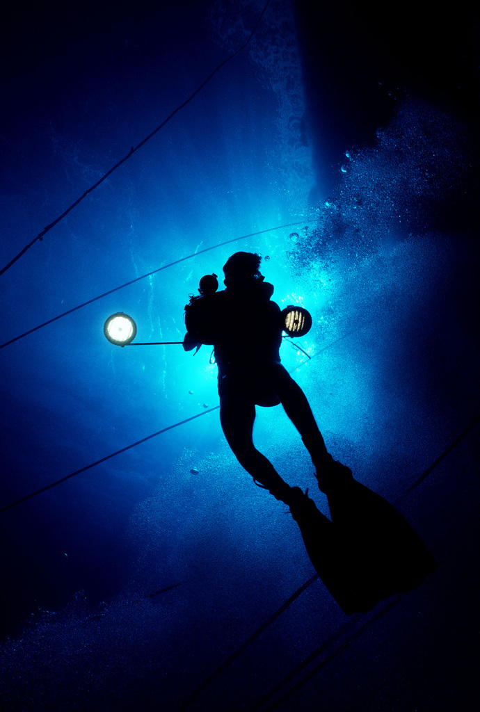 Underwater view of a Navy scuba diver taking photographs during Pacific Submarine Salvage Exercise 83 (PACSUBSALVEX-83) off the coast of Maui