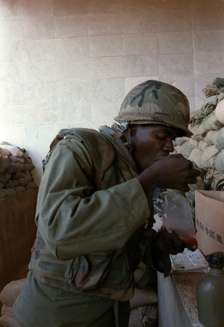A Marine takes time to eat a ready-to-eat (MRE) meal during his participation in a multinational peacekeeping operation. He is a member of Co. A, 1ST Bn., 8th Regt., 24th Marine Amphibious Unit
