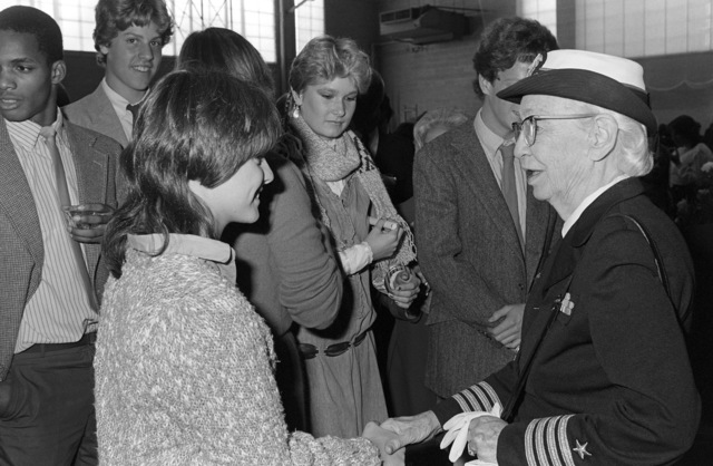 Captain Grace Murray Hopper talks with a student from Brewster Academy at the conclusion of a ceremony to dedicate a computer learning center in her name at the high school