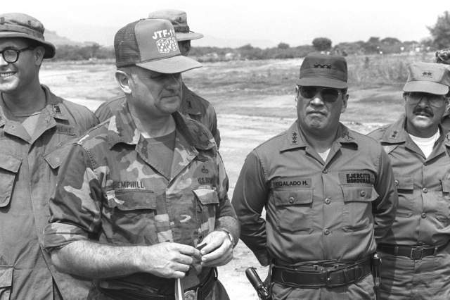 Major General John A. Hemphill of the Joint Training Forces, speaks to Lieutenant General H. Regaldo and other officers of the Honduran Army, at a ceremony to open a new airstrip during the AHUAS TARA II (BIG PINE) operation