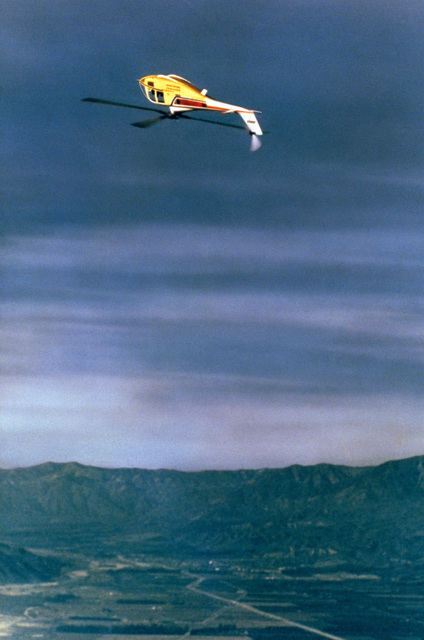 Left side view of the Lockheed model 286 utility helicopter in inverted flight displaying its capability for performing loops and rolls. These capabilities and other aerobatic maneuvers demonstrate the stability and control offered by the rigid rotor system of the model 286 which resembles closely the military XH-51A helicopter