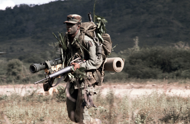 A member of Company B, 1ST Battalion, 187th Infantry, 193rd Brigade Task Force from Panama, participating in the joint US/Honduras training Exercise AHUAS TARA II (BIG PINE). He is equipped with a backpack and armed with an M16A1 rifle and a light anti-tank weapon