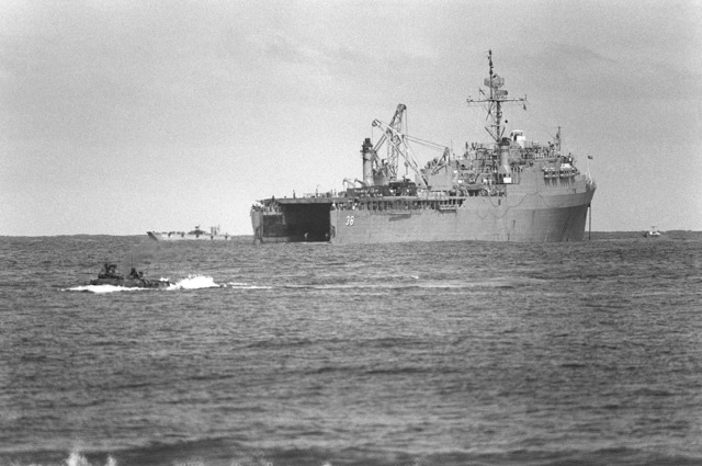 A starboard quarter view of the dock landing ship USS PENSACOLA (LSD 38) being used for a beach assault during the AHUAS TARA II (BIG PINE) operation
