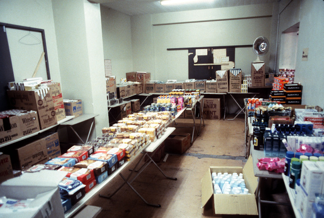 Cigarettes, food and other supplies fill the base exchange at Grantley Adams Airport during Operation URGENT FURY