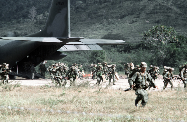 Members of Company B, 1ST Battalion, 187th Infantry, 193rd Task Force from Panama, exit a C-130 Hercules aircraft during the joint US/Honduras training Exercise AHUAS TARA II (BIG PINE)