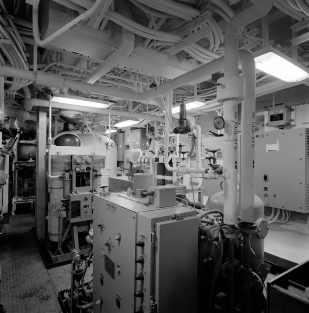 A view of auxiliary machinery room No. 3 aboard the guided missile frigate THACH (FFG 43). The ship, under construction at Todd Pacific Shipyards, is 90 percent complete