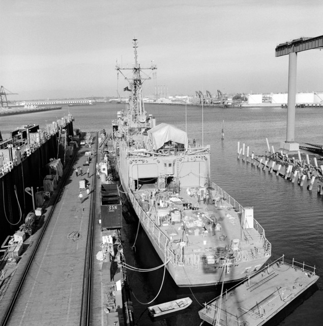 An elevated port quarter view of the guided missile frigate THACH (FFG 43) under construction at Todd Pacific Shipyards. The ship is 90 percent complete