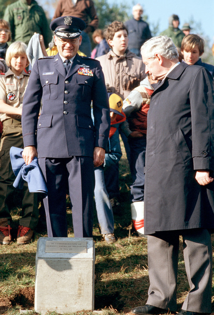 Brigadier General Robert Norman, Commander of the 601st Tactical Control Wing and Otto Meyer, Minister of Agriculture, Forestry, and Wine Production for the state of Rheinland Pfalz, unveil a plaque commemorating the First Annual Tree Planting Ceremony