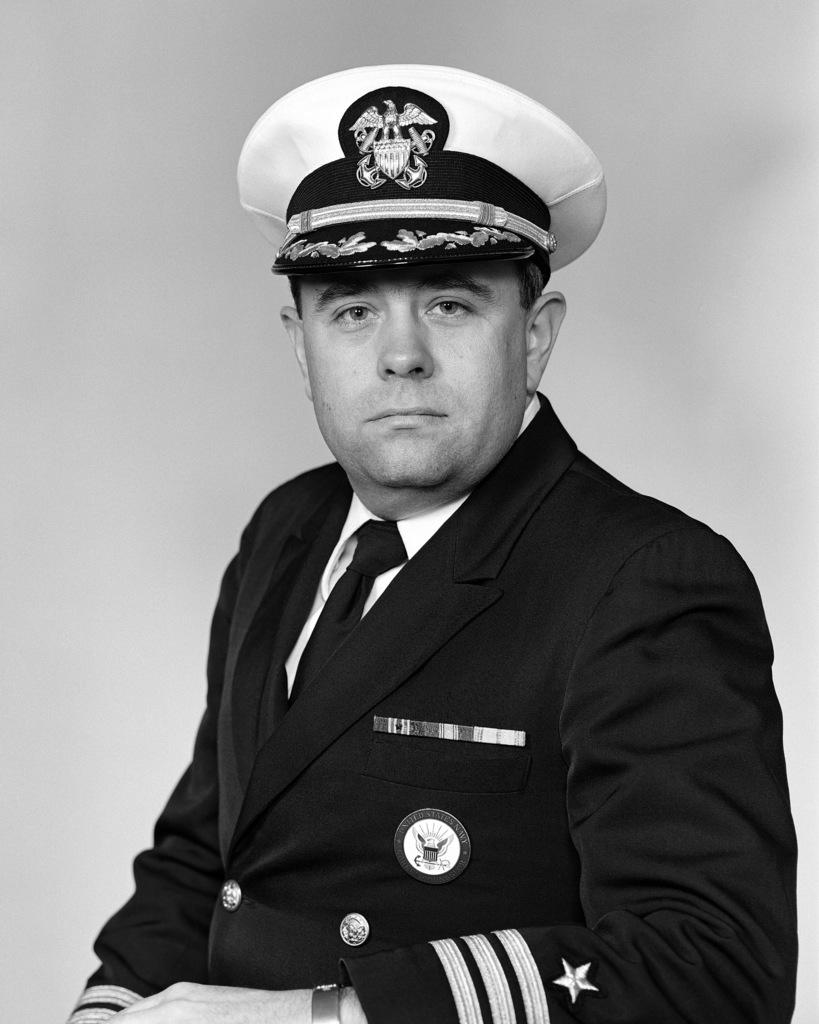 Commander John W. Lainhart, USN (covered)