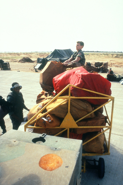 Bags of mail for Marines stationed in Beirut are picked up from the flight line at Landing Zone Brown after delivery by helicopter