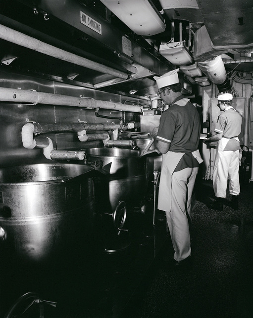 Mess management specialists prepare food in the galley aboard the nuclear-powered aircraft carrier USS ENTERPRISE (CVN 65)