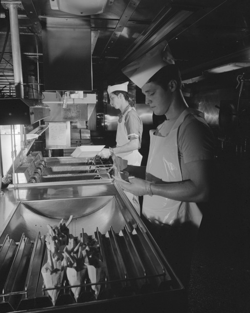 Mess management specialists prepare french fries to be placed on a serving line in the enlisted dining facility aboard the nuclear-powered aircraft carrier USS ENTERPRISE (CVN 65)