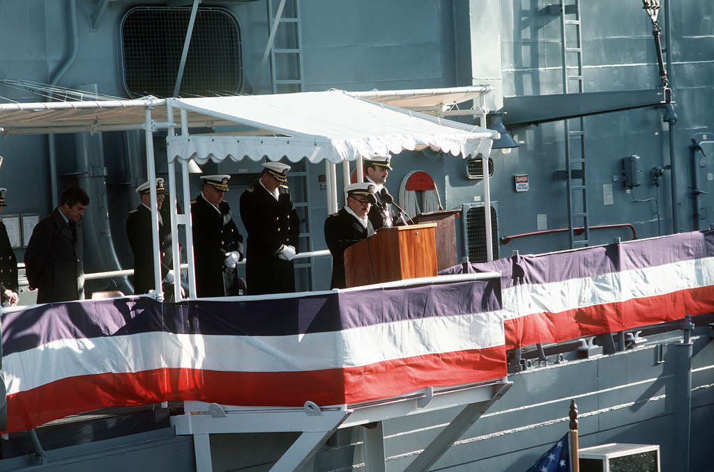 CAPT. Harry F. MacCall, chaplain, gives the invocation during the commissioning ceremony for the Oliver Hazard Perry class guided missile frigate USS DEWERT (FFG-45). Standing behind him is (L-R) William Haggett, president and chief executive officer, Bath Iron Works Corp., Vice Adm. John D. Johnson, USN (Ret), Vice Adm. James A. Lyons Jr., Deputy Chief of Naval Operations, Plans, Policy and Operations, and Cmdr. Douglas Armstrong, commanding officer