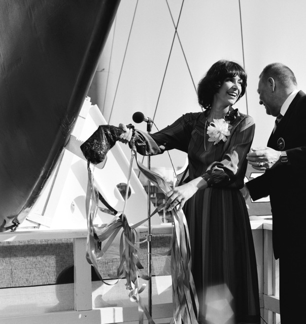 Mrs. George D. Leamer, co-sponsor, is assisted by Len M. Thorell, vice-president and general manager of Todd Pacific Shipyard Corp., as she christens the Oliver Hazard Perry-class guided missile frigate USS GARY (FFG 51), during the ship's launching ceremony