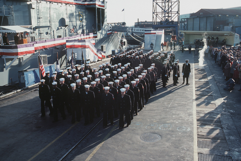 The crew of the USS DEWERT (FFG 45) march in formation during the commissioning ceremony for the Oliver Hazard Perry class guided missile frigate