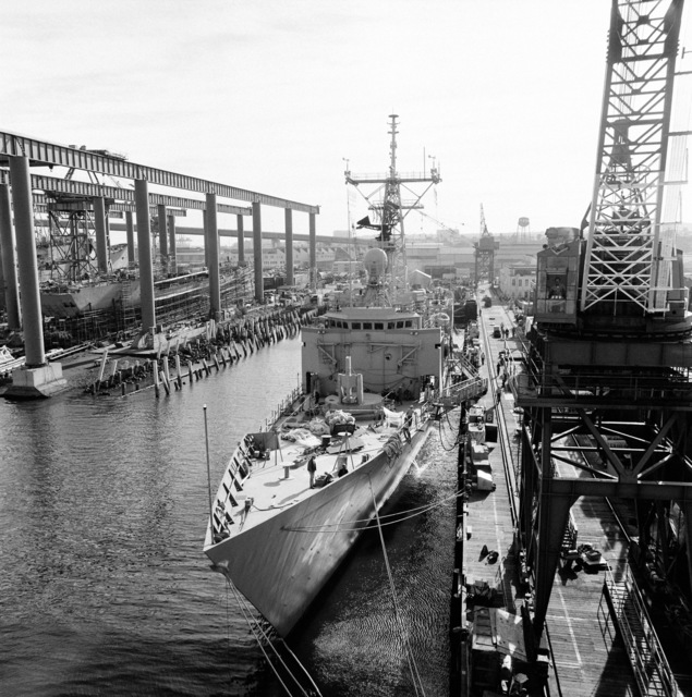 An elevated port bow view of the guided missile frigate THACH (FFG 43) under construction at Todd Pacific Shipyards. The ship is 90 percent complete