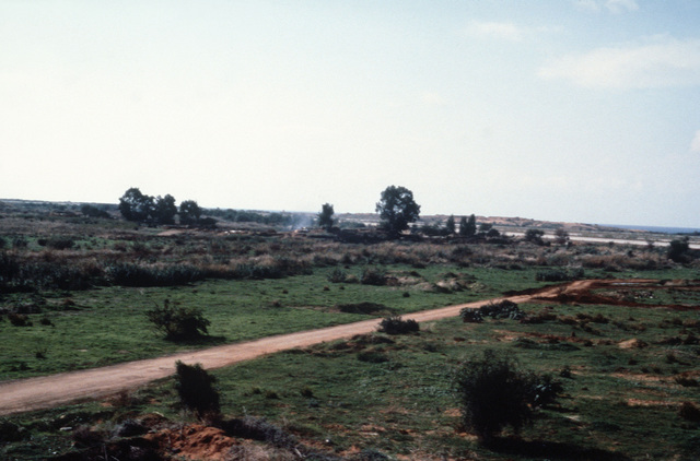 A view from a tank position as Marines observe the area surrounding Checkpoint 73 during a multinational peacekeeping operation
