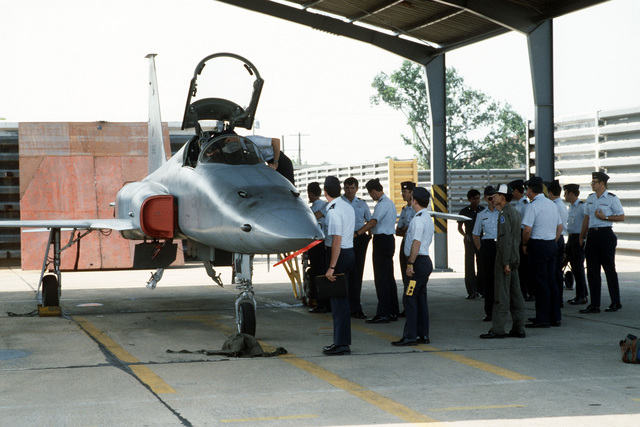 Air crews of the 3rd Tactical Fighter Squadron inspect a Royal Thai Air Force (RTAF) F-53 Tiger II aircraft. They are at the base to participtate in the dissimilar aircraft flying Exercise COMMANDO WEST 6 with members of the Royal Thai Air Force
