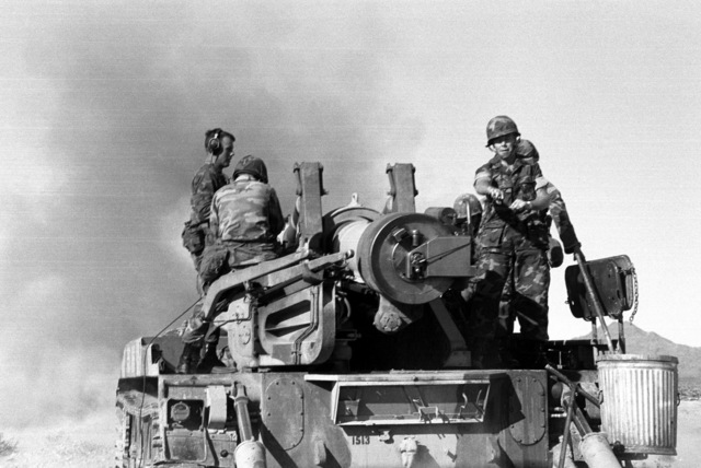 General William R. Etnyre (right), commanding general of the combat center and the 7th Marine Amphibious Brigade, fires the last round from an M107 175 mm self-propelled howitzer of the 3rd Battery, 4th Battalion, 11th Marines, 1ST Marine Division. The unit's M107s will be retired and the battery will convert to 8-inch howitzers