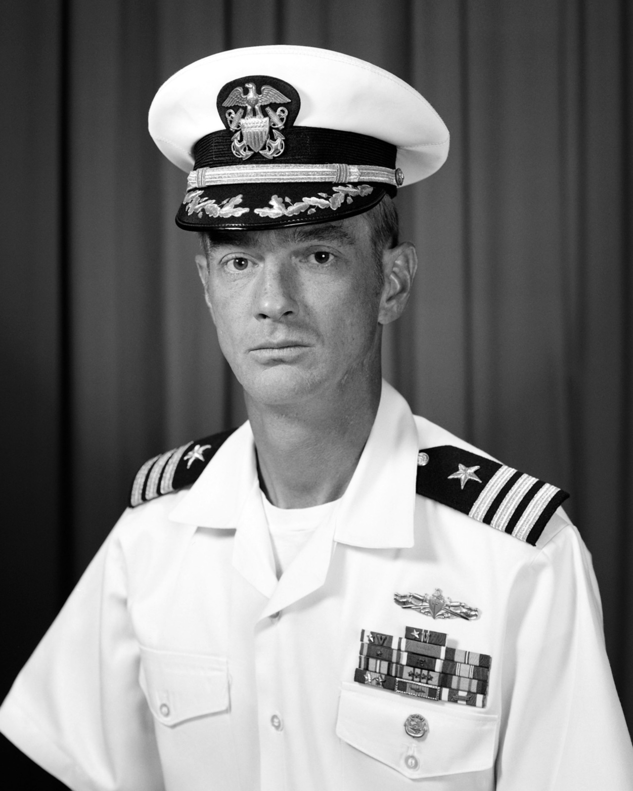 Commander James B. Cook, USN (covered)