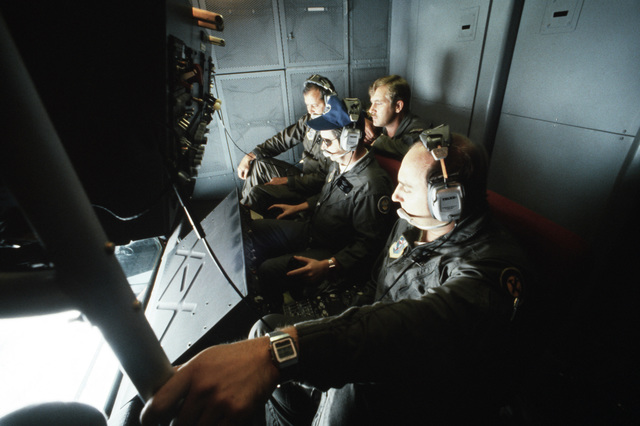 A crew in the refueling station of a KC-10 Extender aircraft, conducts inflight refueling of an F-4 Phantom II aircraft during a tactical large force employment exercise. The crew is assigned to the 9th Air Refueling Squadron, Beale Air Force Base, California