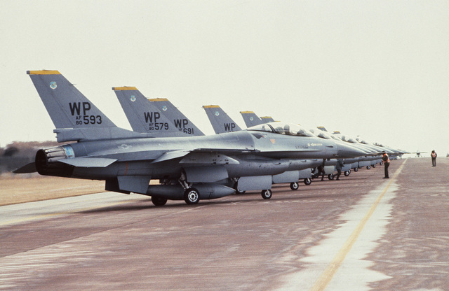 Right side view of F-16 Fighting Falcon aircraft on the flight line during a tactical large force employment exercise