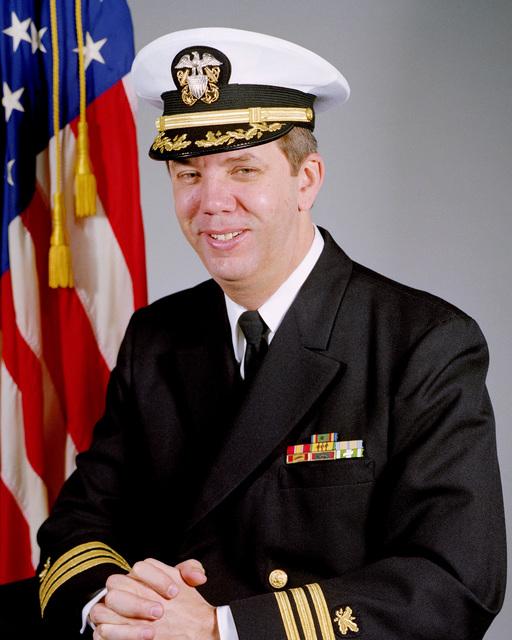 Commander Robert L. Madison, USN (covered)