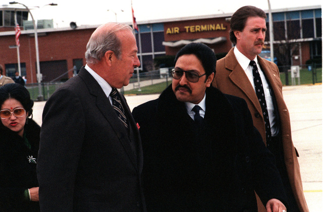 King Birendra Bir Bikram Shah Dev of Nepal (center) talks with Secretary of State George Schultz upon his arrival for a state visit