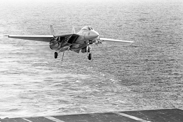 An F-14 Tomcat aircraft lands on the flight deck of the aircraft carrier USS INDEPENDENCE (CV 62) during operations off the coast of Beirut, Lebanon