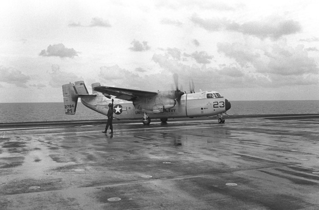 A C-2 Greyhound aircraft after landing on the flight deck of the aircraft carrier USS JOHN F. KENNEDY (CV 67). The aircraft is being used to transport the body of Lieutenant (LT) Mark Adam Lange back to the US. LT Lange was killed when his A-6 aircraft was shot down during a bombing raid over Lebanon